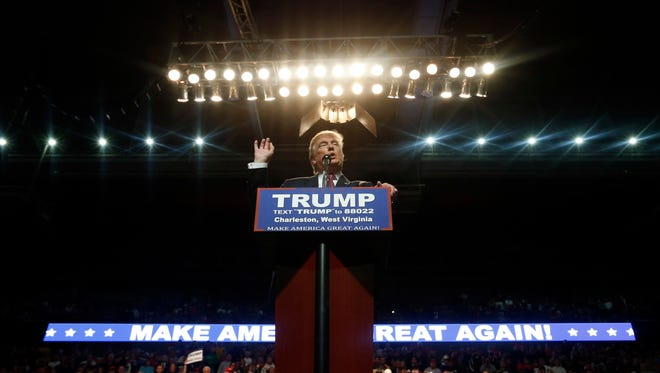 Republican presidential candidate Donald Trump gestures during a rally in Charleston, West Virginia on May 5.