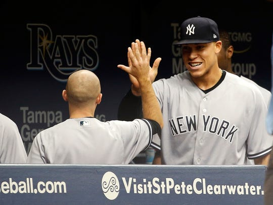 May 21, 2017; St. Petersburg, FL, USA; New York Yankees right fielder Aaron Judge (99) is congratulated in the dugout after he made a diving catch against the Tampa Bay Rays during the sixth inning at Tropicana Field.