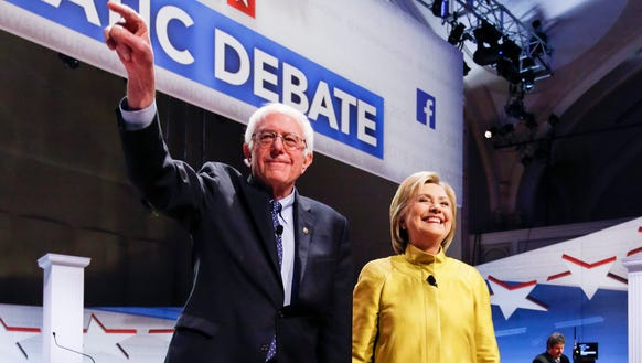 Bernie Sanders and Hillary Clinton participate in the