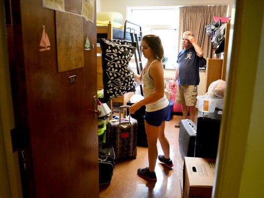 Jon Greco helps his daughter, Christina, move into her dorm room Thursday at Frank J. Sensenbrenner Hall on the St. Norbert College campus.