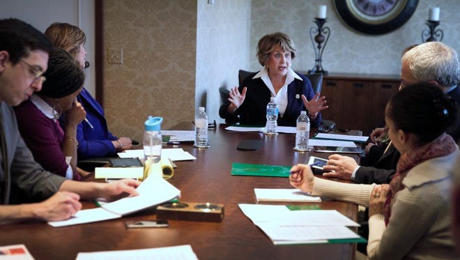 Congresswoman Louise Slaughter, center, speaks with the Democrat and Chronicle Editorial Board.