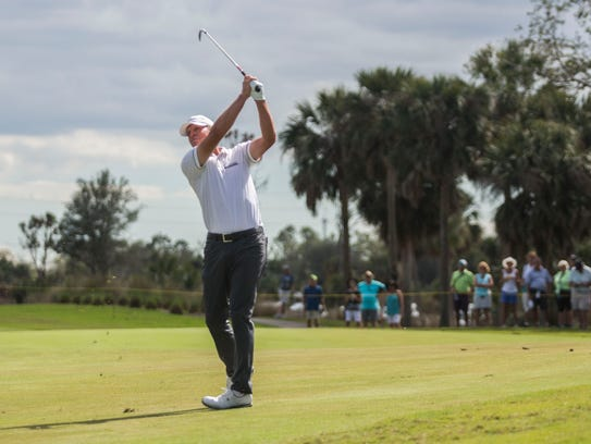 Steve Stricker hits an iron from the fairway on the