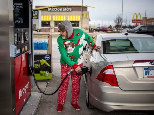 Jimmy Buhalis, of Port Huron, fuels up his vehicle Saturday, Dec. 31, 2016 at the Kroger Gas Station on 24th Street in Port Huron. Beginning in 2017, the gas tax will increase by 7.3 cents per gallon, for a total of 26.3 cents per gallon.