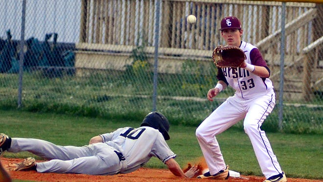 Station Camp High senior Brad Deason receives a pickoff throw at first base as Mt. Juliet's Tyler Brown dives back safely during first-inning action. Deason had two hits in the Bison's 11-4 loss on Wednesday evening.