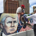 Julian Raven shows a  painting of Donald Trump in Cleveland on July 17, 2016.