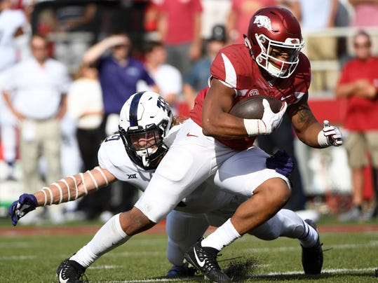 FILE - In this Sept. 9, 2017, file photo, Arkansas running back Devwah Whaley is tackled by TCU defender Mat Boesen just short of the goal line in the second half of an NCAA college football game in Fayetteville, Ark. Boesen got kicked out of a game against Oklahoma. The No. 10 Horned Frogs hope to have Boesen back for an entire game in the rematch against the No. 2 Sooners, this time in the Big 12 championship game on Saturday. (AP Photo/Michael Woods, File)