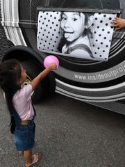 Abiza Reyes gets excited as she sees her picture come