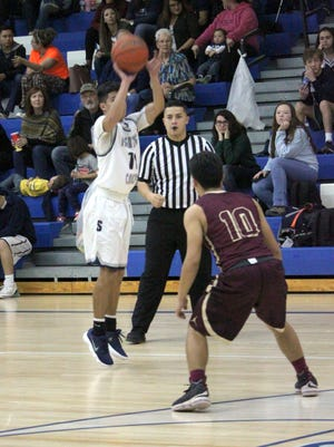 Sal Cruz takes this shot from beyond the arc during a game against Belen last week. He posted 11 points and then added five in the next one against Alamogordo.