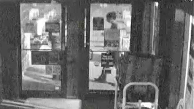 This security camera photo shows a grainy image of the man police suspect attacked a woman outside of the Dollar General Store on Creasy Lane early Sunday.