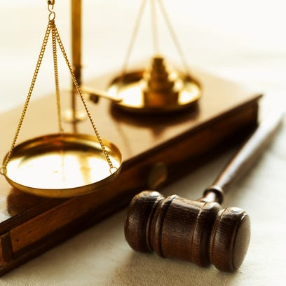 Close-up of weights balancing scales of justice with