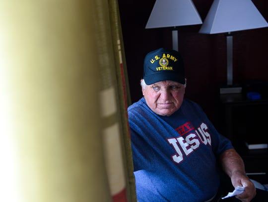Jessie Alexander, wearing a U.S. Army Veteran cap,