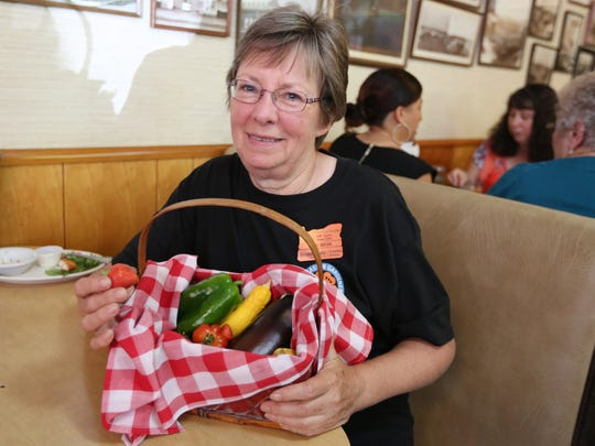 Vicki Brink of Polk County Master Gardeners attends Holding Court on Tuesday, Aug. 23, 2016, at Court Street Dairy Lunch in downtown Salem.