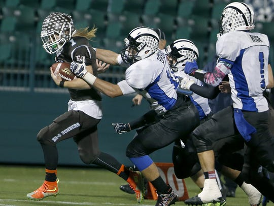 ER/Gananda's Cameron Cleveland is tackled by Bath's Patrick Brewer in the third quarter.