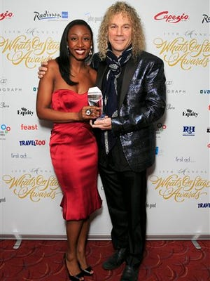 British performer Beverley Knight, left, and US musician David Bryan, winners of Best New Musical for Memphis the Musical, pose for photographers in the winners room, during the The Whatsonstage Awards 2015, at the Prince of Wales Theatre, in London, Sunday.