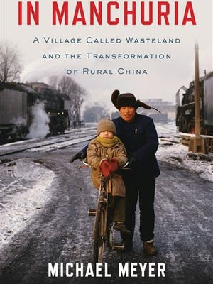 """This book cover image released by Bloomsbury shows """"In Manchuria: A Village Called Wasteland and the Transformation of Rural China"""", by Michael Meyer. (AP Photo/Bloomsbury)"""
