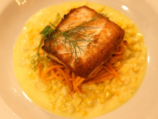 A fennel dusted halibut at the Upstairs Bistro at the