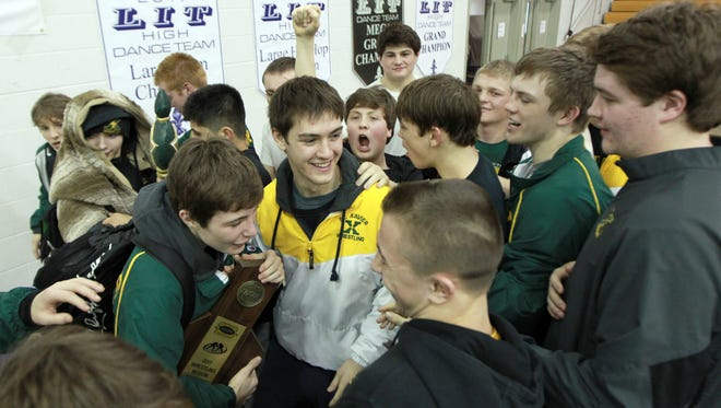 St. Xavier High School celebrates after winning the KHSAA Region 4 Wrestling Championship at Male High School in Louisville, Kentucky.         February 11, 2017