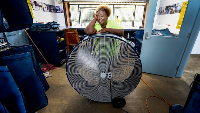 Ed Rice Community Center swimming pool manager Patrica Bailey uses an industrial fan to stay cool while watching swimmers beat the heat Wednesday afternoon. Memphis is experiencing its first heat wave of the summer as temperatures are expected to reach highs in the mid-90s into next week according to National Weather Service Memphis.