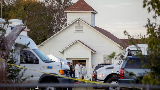Investigators work at the scene of a deadly shooting at the First Baptist Church in Sutherland Springs, Texas, on Nov. 5, 2017.
