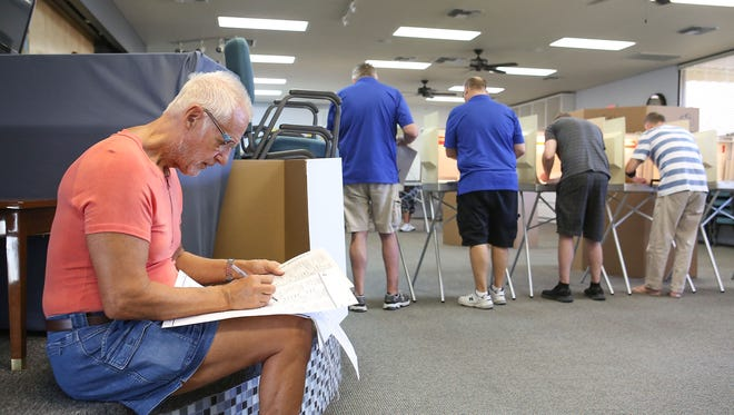 Clas Ekwall, left, votes at the Center for Spiritual Living in Palm Springs, June 5, 2018.