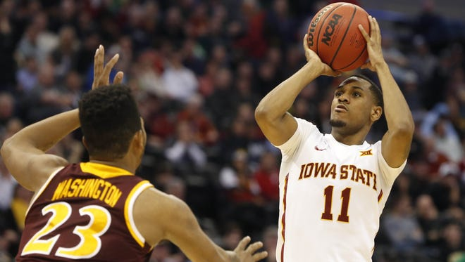 Iowa State guard Monte Morris (11) takes a shot over Iona forward Jordan Washington (23) Thursday, March 17, 2016, during their first round game at the NCAA men's basketball tournament at the Pepsi Center in Denver.