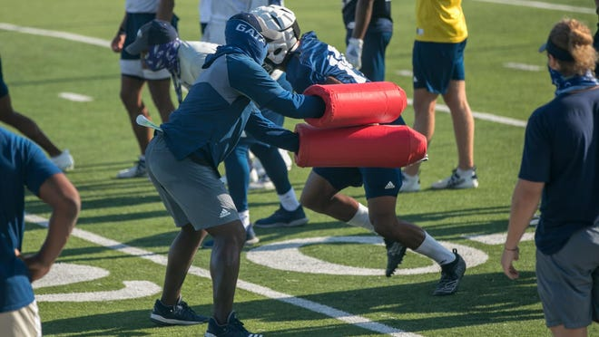 The Georgia Southern team runs drills during the first football practice of the fall on Friday morning at Paulson Stadium in Statesboro.
