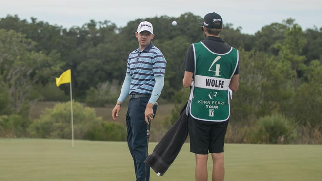 Jared Wolfe, from Ponte Vedra Beach, Florida, flips a ball to his caddie prior to his putt on the ninth hole during the third round Saturday of the Savannah Golf Championship at The Landings Club's Deer Creek Course.