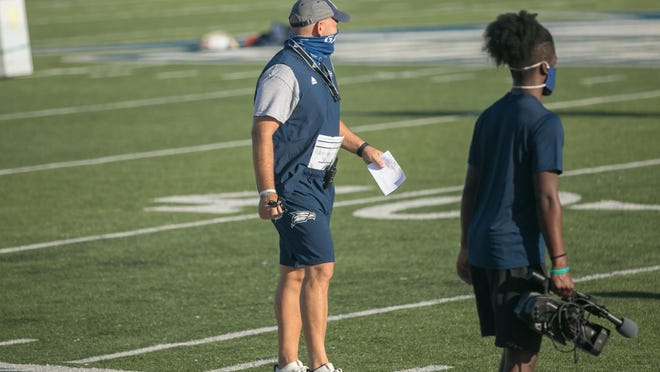 Georgia Southern head coach Chad Lunsford keeps an eye on his players during the first football practice of the fall on Friday morning at Paulson Stadium in Statesboro.