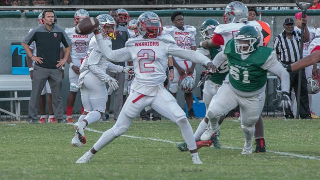 Jenkins High quarterback Patrick Blake throws downfield early in the game against Windsor Forest last year at Garden City Stadium.