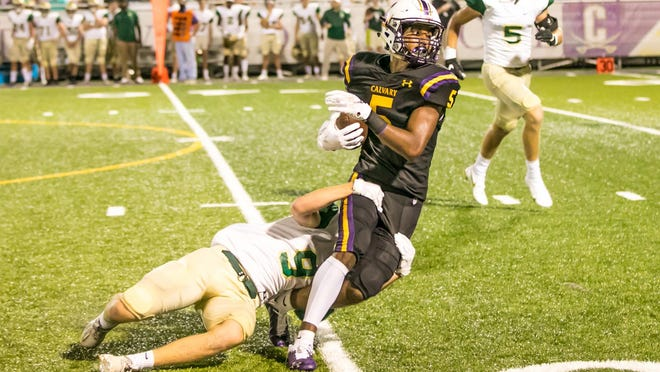 Calvary Day's Brogan Corta (5) is brought down after a nice gain against Bulloch Academy on Friday night at Calvary. The Cavaliers won 48-7.