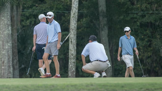 The final foursome in Sunday's final round of the 2020 Savannah City Amateur Golf Championship survey the 17th green. John Skeadas II, squatting, won the tournament with a two-day score of 8-under 134.
