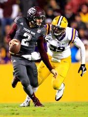 LSU defensive end Jermauria Rasco pressures Texas A&M quarterback Johnny Manziel during a game in Baton Rouge, La., in November 2013.