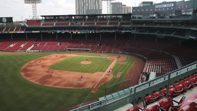 The Red Sox play an intra-squad baseball game at a Fenway Park empty of fans on Thursday.