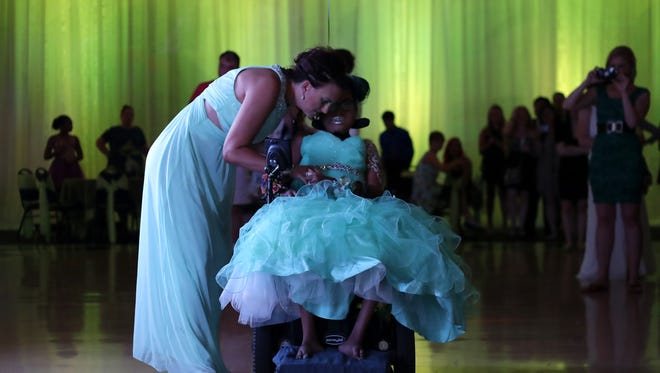 Jen Bolen talks and dances with her daughter Jerika at her prom Friday  at the Grand Meridian in Appleton, Wis.