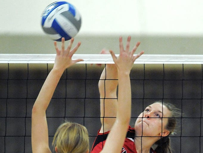 Penfield's Emma Stoltz, right, hits over the block of Schroeder's Emma Dunn.