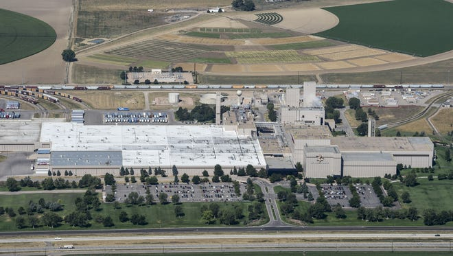 Farmland west of the Anheuser-Busch Fort Collins brewery, seen in this August 2015 file photo, sits in the city's Mountain Vista subarea. Max Moss has a contract on 860 acres west of the brewery for a potential development.