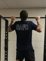 A San Angelo firefighter works out at the Central Fire