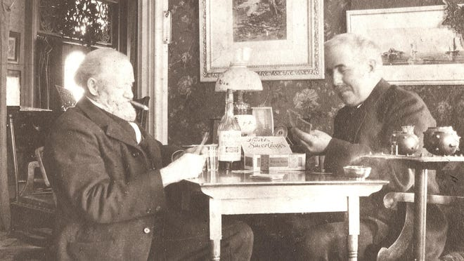 """Cheese Barons Frank Hurd, left, and Willis J. Eldridge playing cards in the parlor of Hurd's home at 50 S. Chillicothe Road, commonly referred to by many as the """"Big Green Monster."""""""