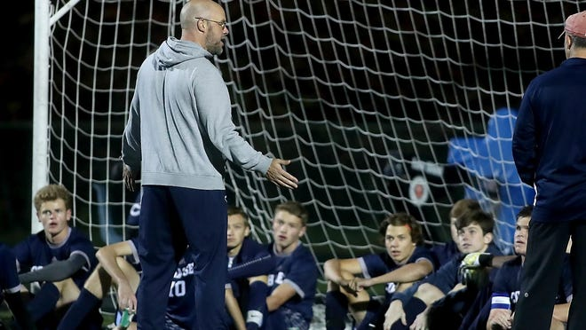 Head coach Jim Willis talks to his team during halftime of their game against Norwell at Cohasset High on Tuesday, Oct. 15, 2019.