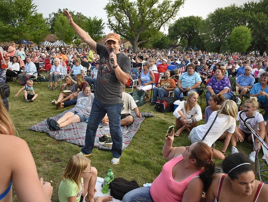 Johnny Holm worked the crowd at a 2015 Summertime by