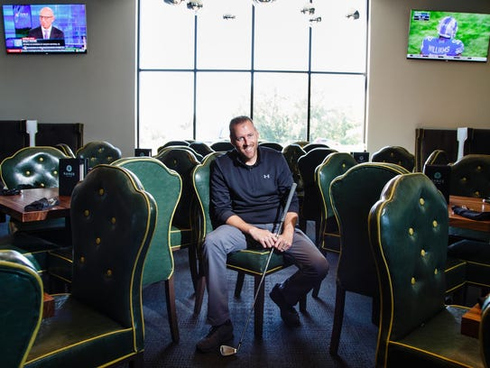 Range Grill + Golf owner Steve Garrels poses for a