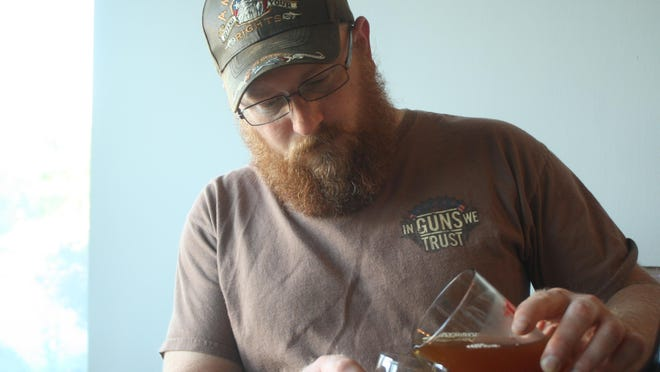Scott Webb of Farmington pours beer at The VB Brewery's Community Brew Night in Victor.