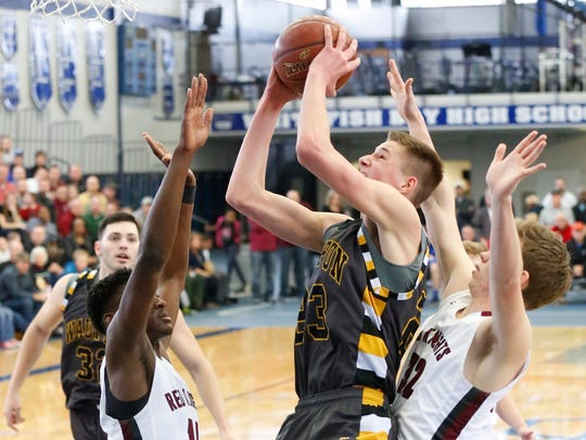 Waupun's Colton Homan is defended by a couple of Milwaukee