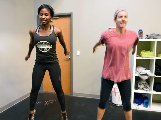 Fitness instructor Staci Buford, left,  works out next to Whitney Byerly during a Body Weight Burn class at Climb Nashville Nov. 30.
