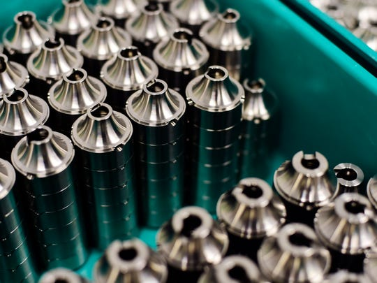 Recently manufactured baffles are stacked at Freedom Armory Machine Works in Springfield Township. These pieces disrupt the pressure wave that follows a bullet leaving a firearm, muffling and reducing the sound that hits surrounding ears by 30 to 40 decibels.