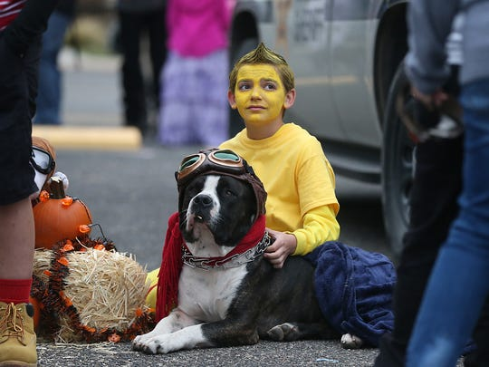 Keaton Lacy and his dog team up as Snoopy and Woodstock during the Tom Green County Sheriff's Office's second annualHalloween Trunk or Treat Tuesday, Oct. 31, 2017.