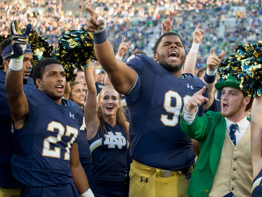 Fighting Irish cornerback Julian Love (27) and defensive