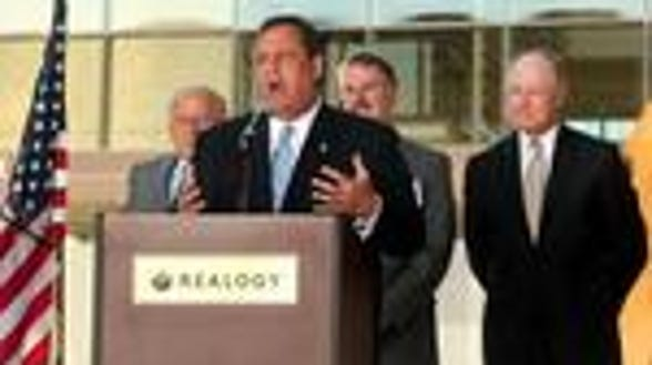 Gov. Chris Christie with Jon Hanson of Hampshire at a ribbon-cutting in Madison. (file photo)