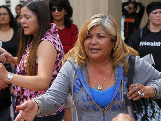 Rita Acosta, mother of jose Velasco, speaks to the media outside of the Monterey County Superior Court in Salinas after her son's court hearing.