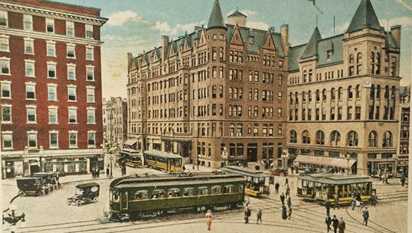 The Schmidt/Rupp building is to the right of the similar Colonial Hotel.